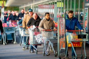 people queuing at supermarket in york social distancing covid 19